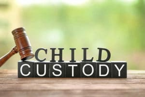child custody spelled out in block letters with gavel sitting on them